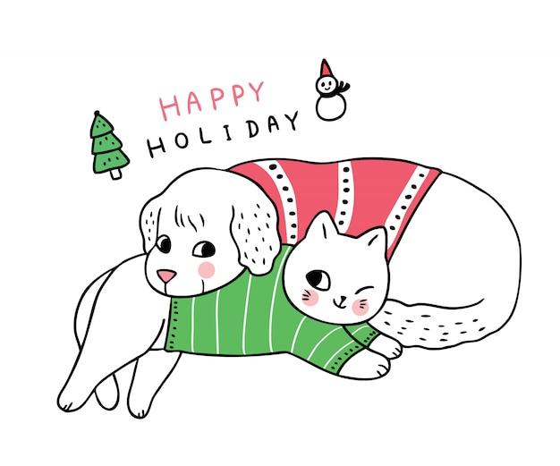 Мультфильм милый рождество собака и кошка спит. Premium векторы