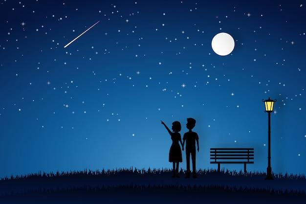 Любовник гуляет в саду и смотрит на луну Premium векторы