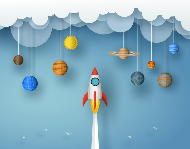 Запуск ракеты в облако с оригами планеты и солнца. векторный дизайн в стиле бумаги вырезать Premium векторы