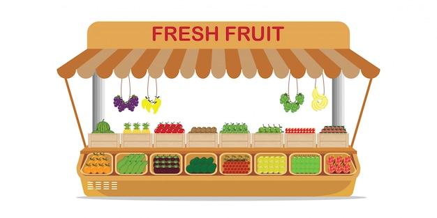 木箱に新鮮な果物と地元の農産物市場のフルーツショップ。 Premiumベクター