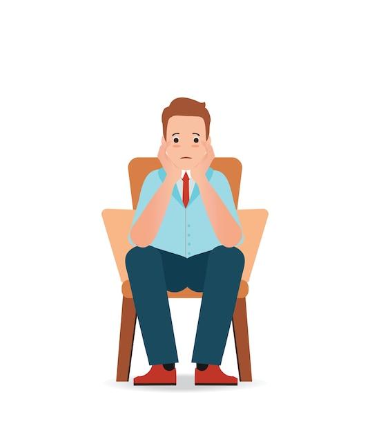椅子に座っている悲しみとストレスを感じる不安な男 Premiumベクター