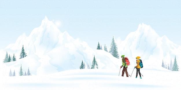 Альпинисты горной пары с рюкзаками идя через сильный снегопад в зимнем сезоне. Premium векторы