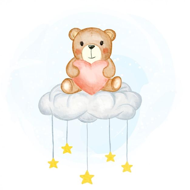 Милый медвежонок держит форму влюбленности сидя на иллюстрации акварели звёздных облаков Premium векторы