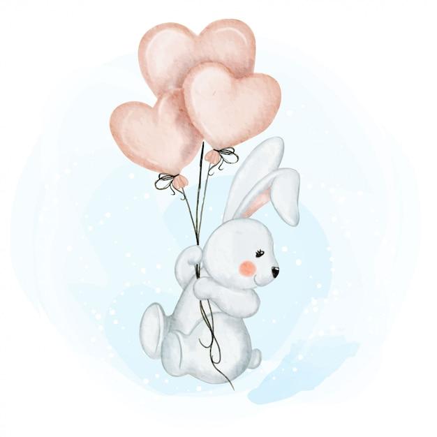 Милый маленький кролик с воздушным шариком Premium векторы