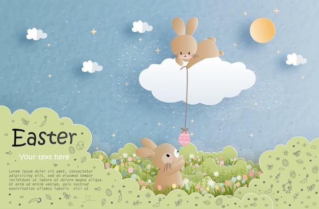 チューリップと花のかわいいウサギとイースターカード Premiumベクター