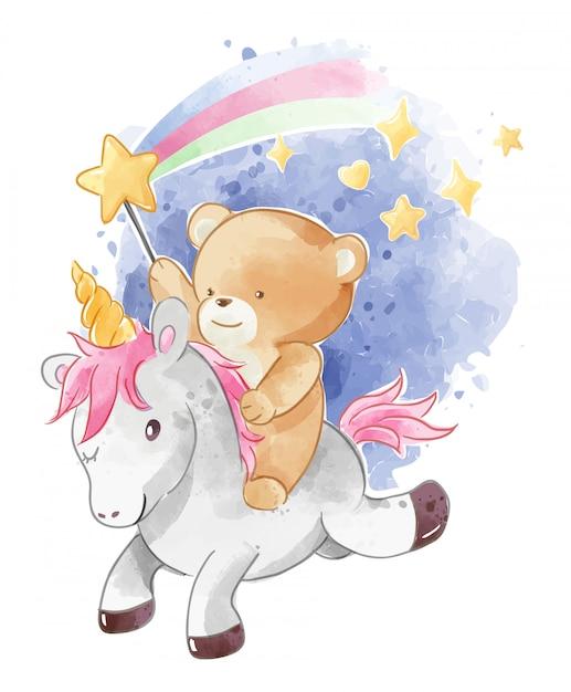 輝く星とユニコーンに乗ってかわいいクマ Premiumベクター