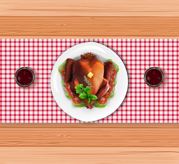 木製のテーブルに赤ワインを入れた皿に焙煎した七面鳥 Premiumベクター