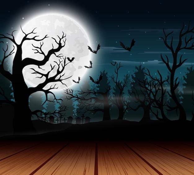 ハロウィーンの日の満月の背景と屋外ビュー Premiumベクター