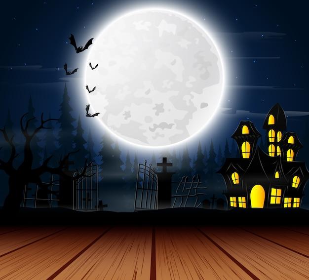 満月の幽霊のある家とハロウィーンの背景 Premiumベクター