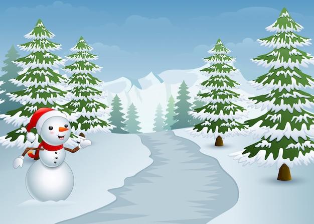 雪の多いサイプレスの木がある道路の側の雪だるま Premiumベクター