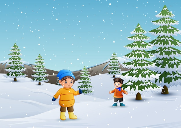 冬の風景で遊んでいる子供たち Premiumベクター