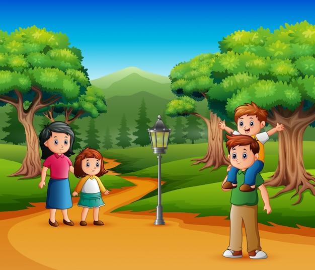 幸せな家族は森の中を歩く Premiumベクター