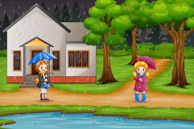 Мультфильм две девушки с зонтиком под дождем Premium векторы