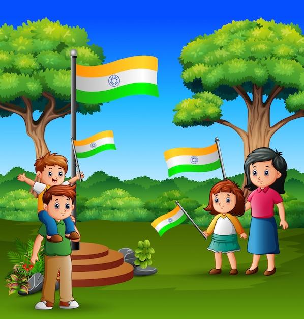 幸せな家族、自然の国旗を保持 Premiumベクター