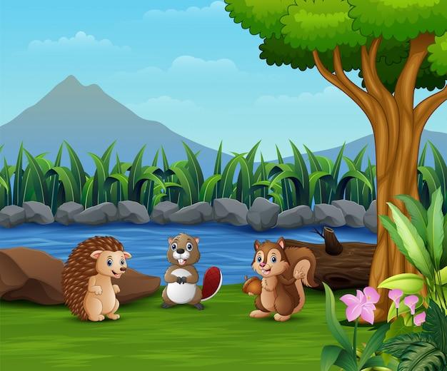 川で遊ぶ小動物 Premiumベクター