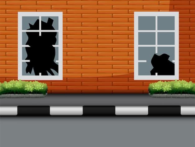 赤レンガの壁に割れたガラスを持つウィンドウ Premiumベクター