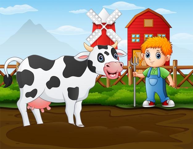 彼の納屋の前に牛を持つ農家 Premiumベクター