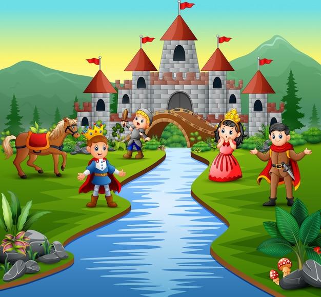 Рыцарь с принцессой и принцем в замковом пейзаже Premium векторы