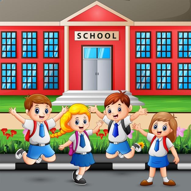 幸せな学生が学校に通う Premiumベクター
