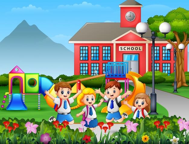 校庭で制服を着た漫画の子供たち Premiumベクター