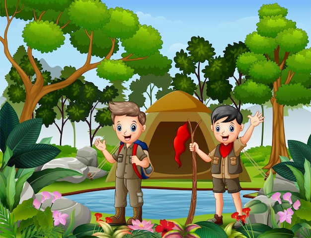 森でキャンプをしている二人の少年 Premiumベクター