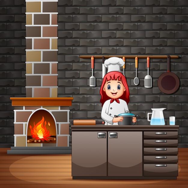 食事を準備するキッチンで幸せな笑みを浮かべてシェフ Premiumベクター