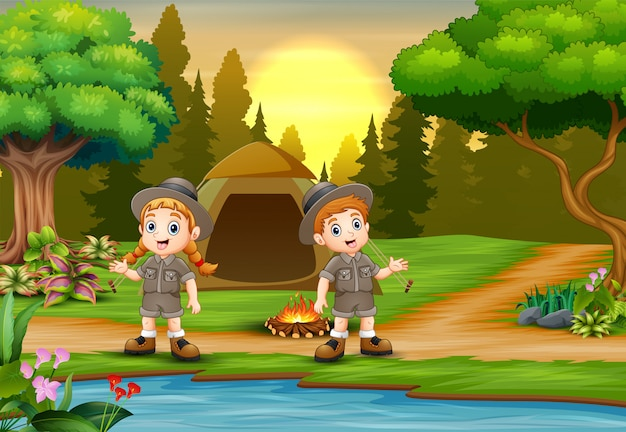 夕日の風景と背景をキャンプの子供たち Premiumベクター