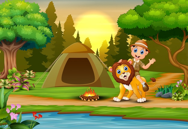 飼育係の少年と日没の風景でキャンプ場のライオン Premiumベクター