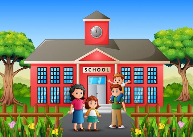 両親は子供たちを学校に連れて行きます Premiumベクター