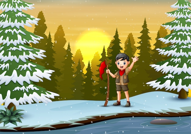 Скаутский мальчик с красным флагом в зимнем пейзаже Premium векторы