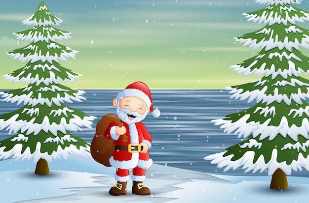 Санта-клаус с мешком подарков в лесу Premium векторы