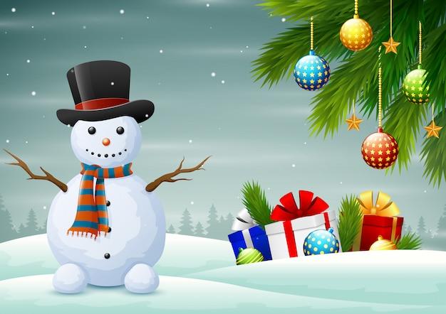 Милый снеговик с подарками на зимнее рождество Premium векторы