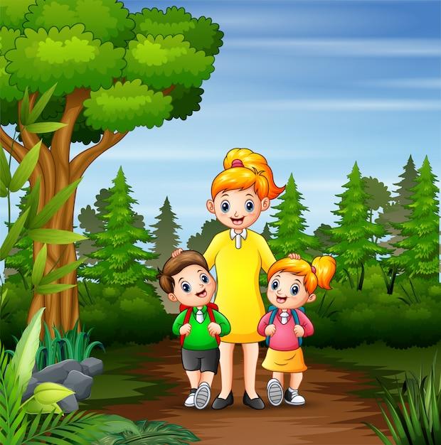 幸せな子供たちは母親と一緒に学校に行く Premiumベクター