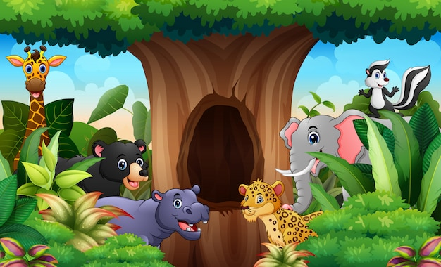 中空の木の風景の下の動物園の動物 Premiumベクター