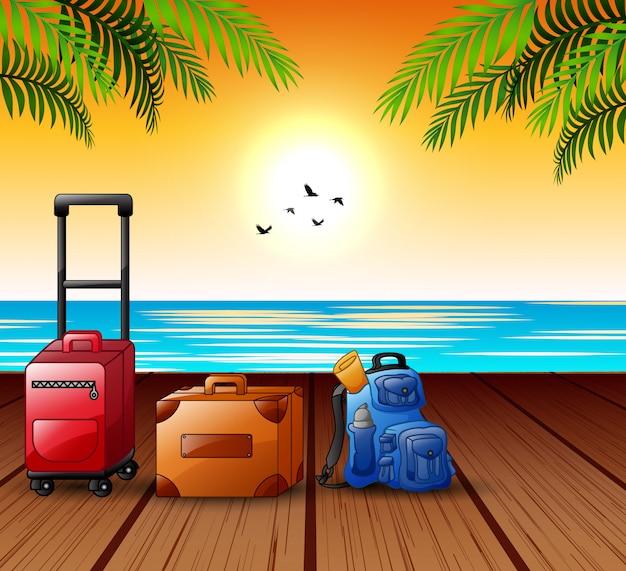 港でいっぱいのスーツケースと夏の休暇の概念 Premiumベクター