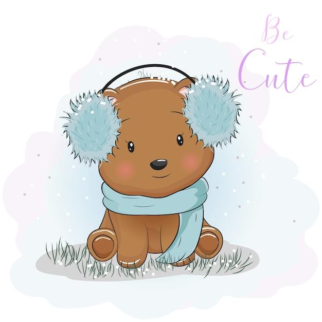 毛皮のヘッドフォンとスカーフとかわいい漫画のクマ Premiumベクター