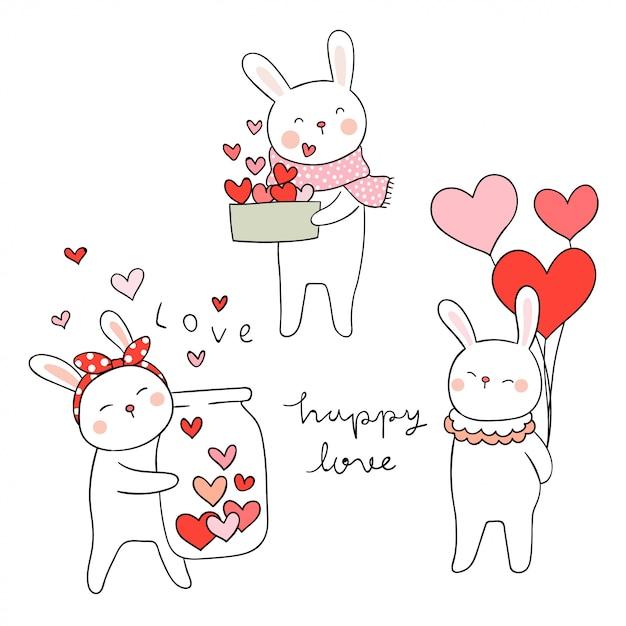 愛のために小さな心でウサギを描く Premiumベクター