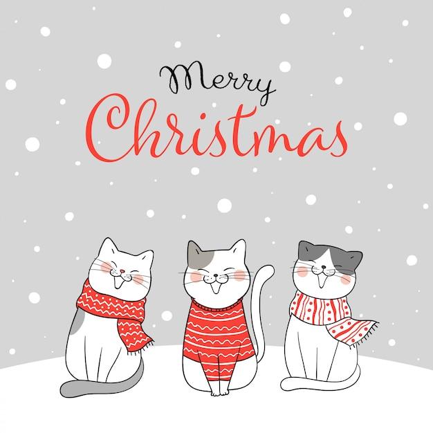 Веселая рождественская открытка с кошками, сидящими в снегу Premium векторы