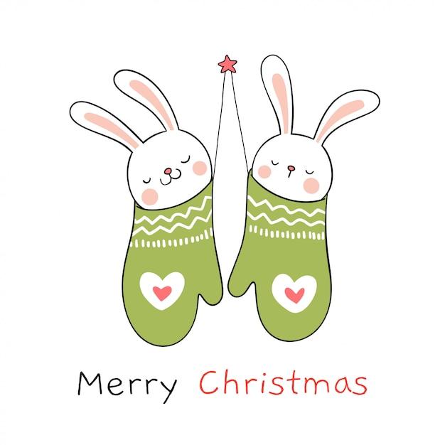 クリスマスと新年のために緑のミトンでウサギを描きます。 Premiumベクター