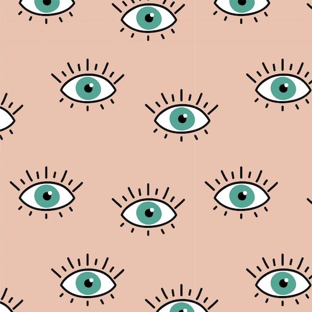 目のパターンとピンクの背景 Premiumベクター