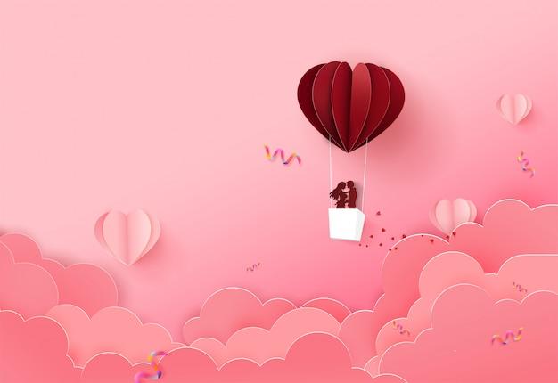 クラウド上の折り紙バルーンフロートとバレンタインデーの背景。 Premiumベクター
