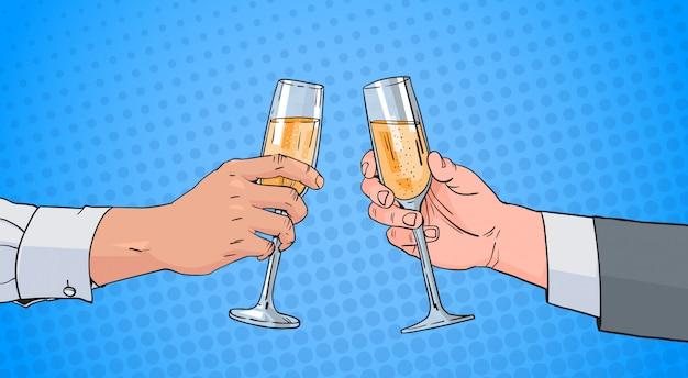 男性のカップルの手シャンパンワインのガラスの乾杯ポップアートレトロをピンぼけ背景をピンで留める Premiumベクター