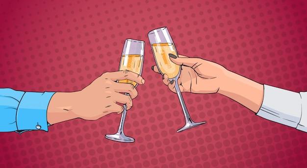 カップルの手がシャンパンワインのガラスを乾杯ポップアートレトロをピンぼけ背景 Premiumベクター