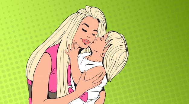 小さな女の子にキスをする女性、ポップアートの上の娘と母レトロピンバックグラウンド Premiumベクター