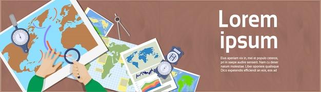 手ホールド虫眼鏡研究マップ職場の地理学と地図作成の概念のトップアングルビュー Premiumベクター