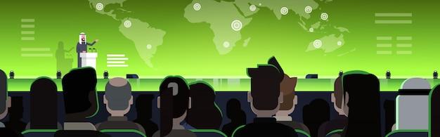Бизнес-конференция с арабским бизнесменом или политиком, говорящим с трибуны над картой мира спикер арабского языка на международной встрече Premium векторы
