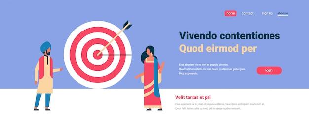 Индийская пара постоянная цель стрелка цель успех бизнес-концепция Premium векторы