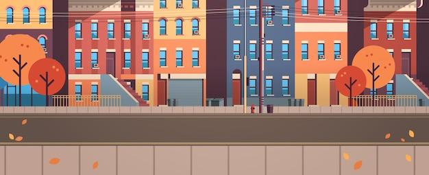 Город здание дома вид осень улица листья падать недвижимость квартира горизонтальный Premium векторы
