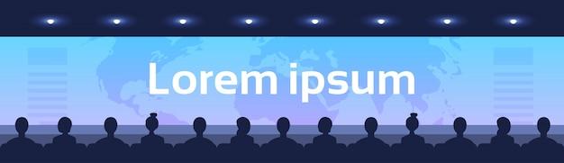 人々座っている映画館ホールバックリアビュー見る画面世界地図国際ビジネスグローバリゼーション Premiumベクター