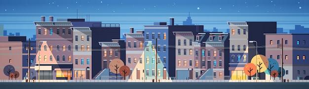都市の建物の家夜景スカイラインバナー Premiumベクター